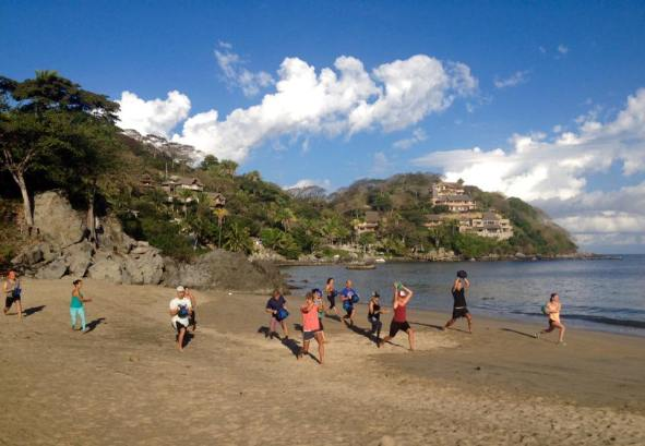 Shanti leading a beach group class in Sayulita, Mexico