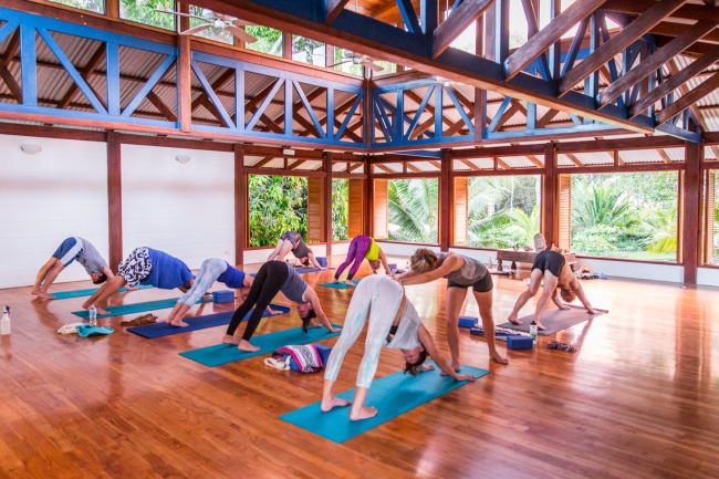 How to Return Back to Normal Life After your Costa Rica Yoga Retreat Blue Osa Yoga Class with Ewa giving Adjustment