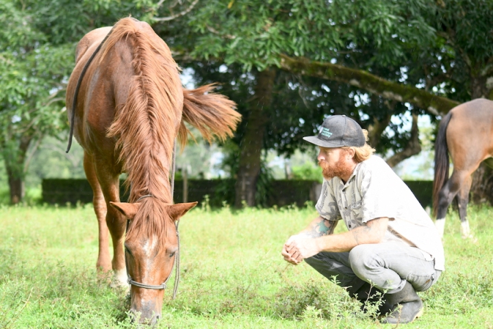 Horse Therapy Costa Rica Osa Peninsula New Year's Eve Yoga Retreat Red Haired Guy With Brown Horse